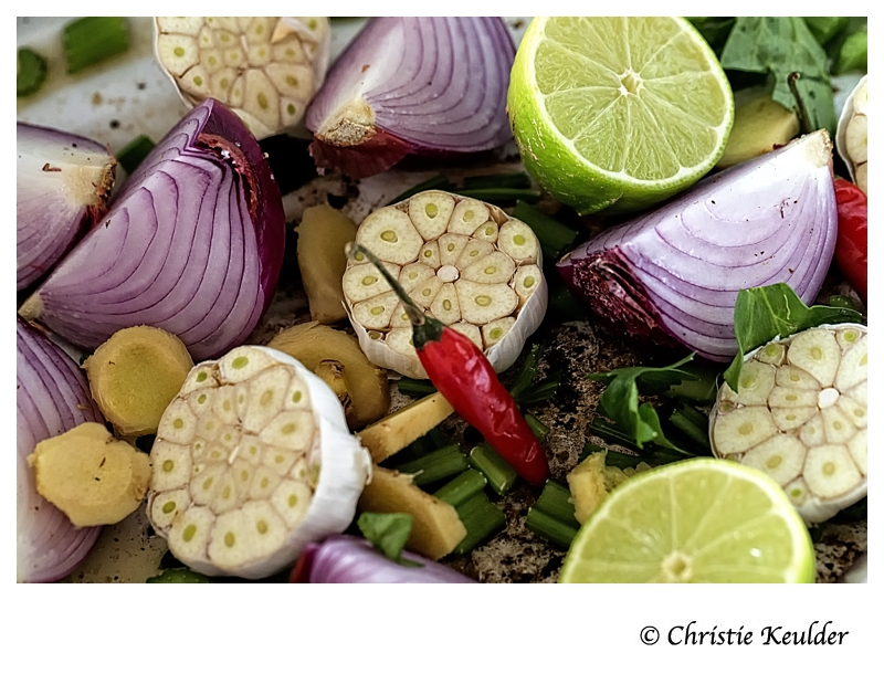 Ingredients for roasted garlic, onions, lemons and spices.