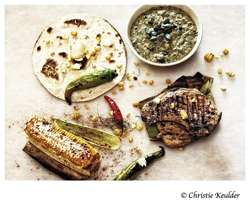Grilled pork chops with pumpkin seed mole